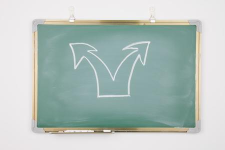 Arrow drawn on a blackboard photo