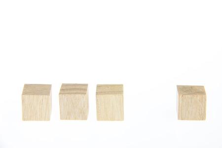 Wooden toy blocks isolated on white background photo