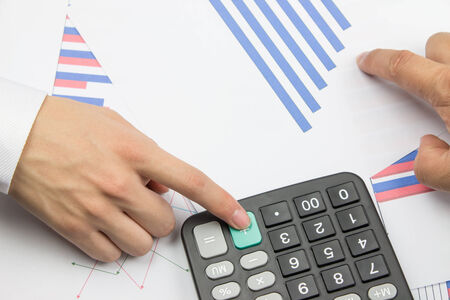 financial statements: Business people in the calculation of the financial statements Stock Photo
