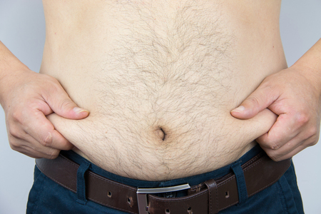 Close-up mans belly photo