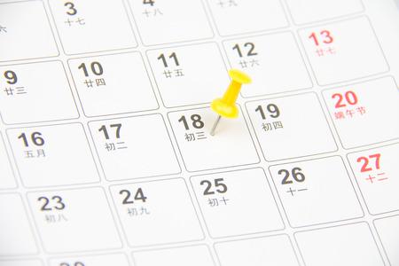 thumb tack: Thumb tack on calendar page