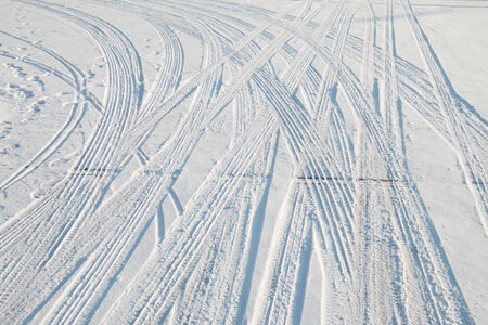Car tire track in snow photo