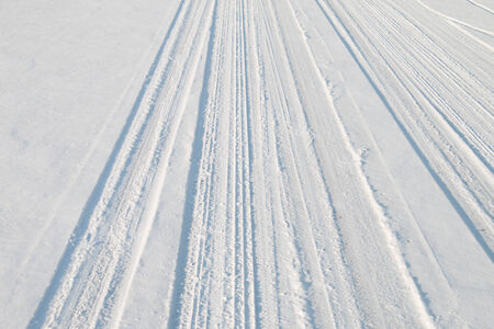 Car tire track in snow photo