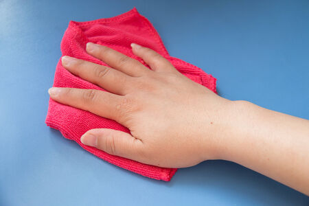 Hand wiping the table photo
