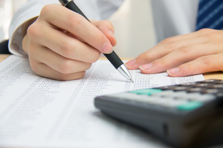 Businessman calculating the financial statements Imagens