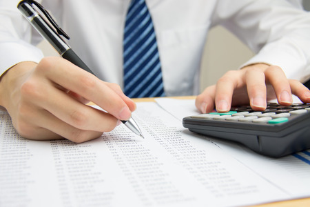 financial statements: Businessman calculating the financial statements Stock Photo