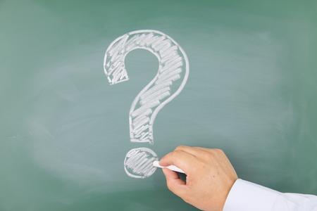 Question mark drawn on a blackboard photo