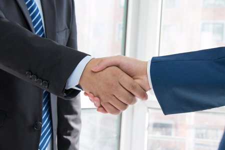 business people handshaking photo