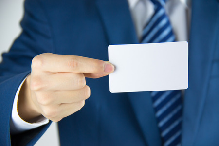 Man hand holding a business card photo