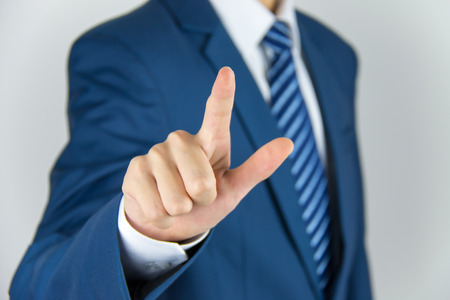 businessman hand pushing screen photo