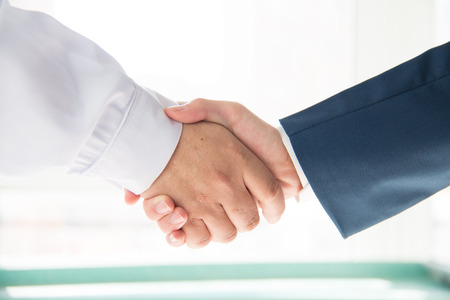 doc: Doctor and businessman shaking hands