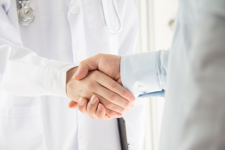 chinese medical: Doctor and businessman shaking hands