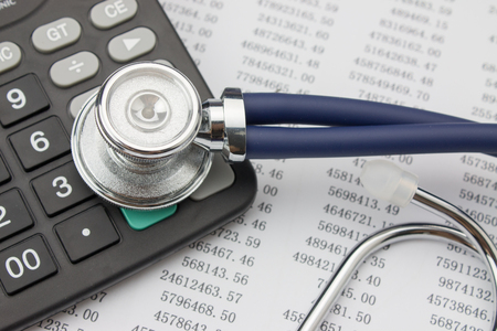 medical tools: Stethoscope and calculator Stock Photo