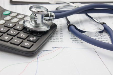 billing: Stethoscope and calculator Stock Photo