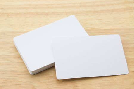 name calling: Blank business cards on a desk