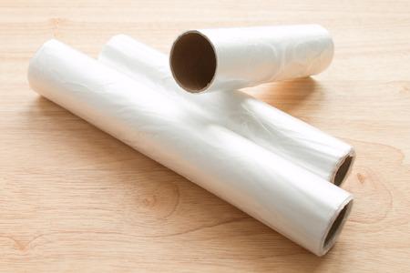 plastic wrap isolated on wood