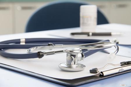 Close-up of stethoscope and folder Imagens