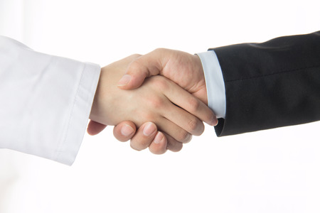 Doctor and businessman shaking hands Stock Photo - 37885767