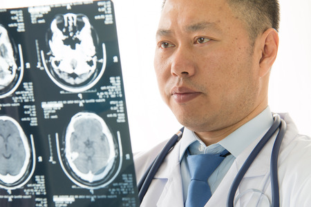 Asian male doctors radiologist studying patients x-ray photo