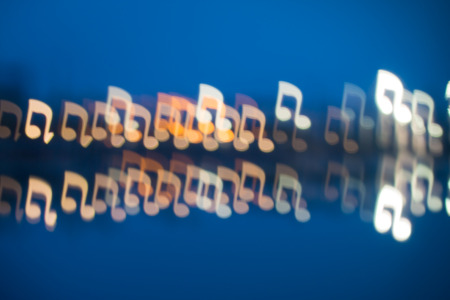 notation: Fuzzy music notation shaped lights, defocused background
