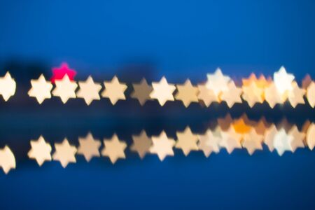 star shaped: Fuzzy star shaped lights, defocused background Stock Photo