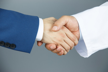 Doctor and businessman shaking hands Stock Photo - 40149800