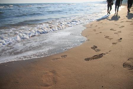 Footprints on the beach Banco de Imagens