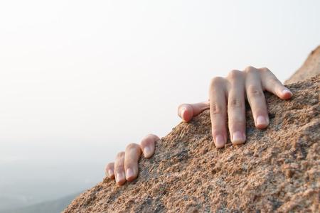 Rock climbing, close-up finger
