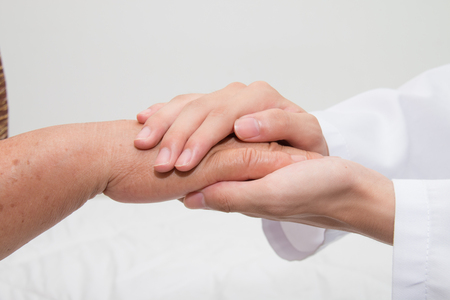 hand care: Doctor holding an old womans hand