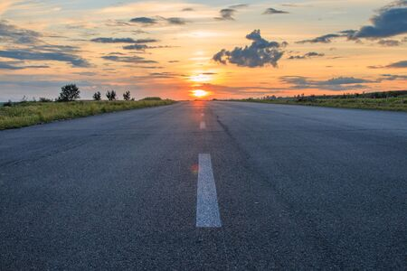 countryside landscape: Rural road in the sunset