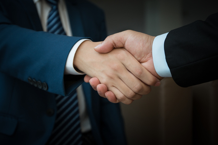 negotiation business: business people handshaking