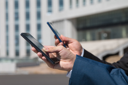 phone message: Businessman using smartphone
