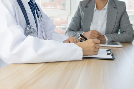 prescribing: Doctor and patient Stock Photo