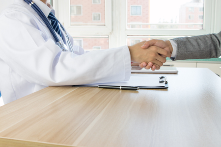 business support: Doctor and businessman shaking hands