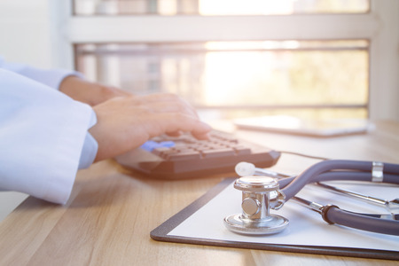 Close-up of stethoscope and folder on background of doctors at work Imagens