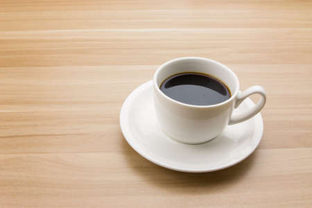 taza cafe: Coffee cup on the desk