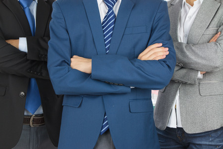 asian adults: business team standing in a row at office Stock Photo