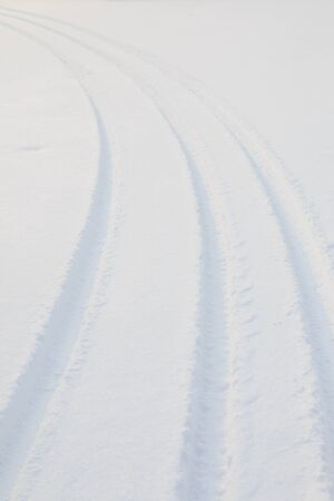 winter tire: Car tire track in snow
