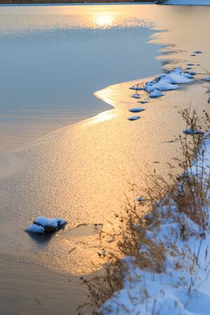 frozen river: Frozen river in the sunset Stock Photo