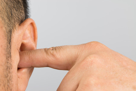 unresponsive: Man cover your ears with your fingers