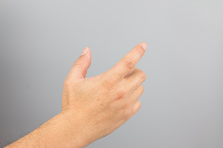 Man hand sign isolated on gray background