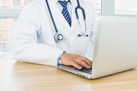 Doctors using laptop at work