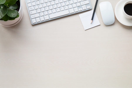 mug of coffee: Office supplies on the wooden desk Stock Photo