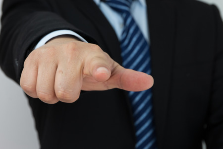 pointed arm: Businessman hand in pointing