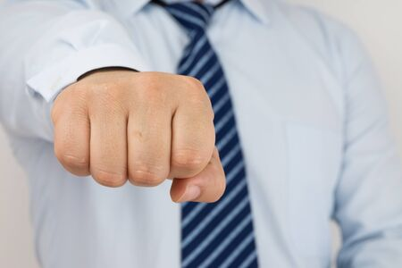 resolved: Businessman fist protrudes Stock Photo