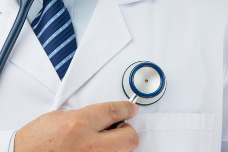 auscultate: Doctor holding a stethoscope auscultation