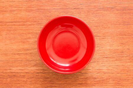 empty bowl: Empty bowl on a wooden board