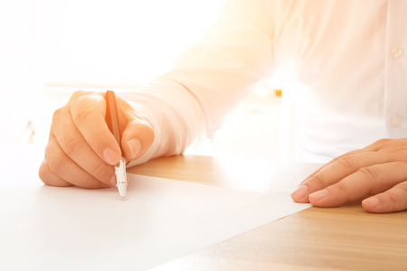Businessman signing documents