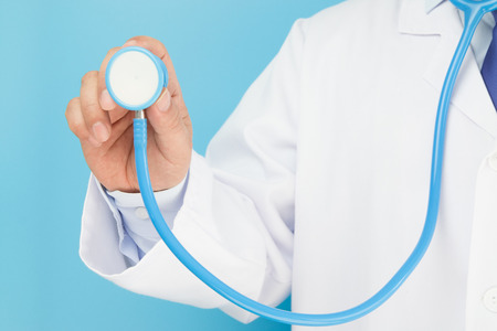 auscultation: Doctor holding a stethoscope auscultation
