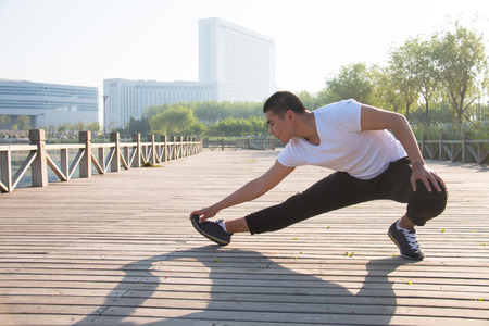 Young Asian man doing stretching